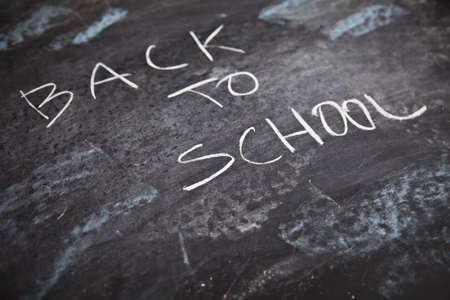Inscription on a school chalkboard - back to school  Stock Photo - 5427865