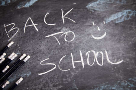 Lesson at school - writing on chalkboard  photo
