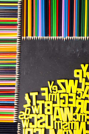 Blackboard, wooden pencils and back to school photo