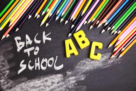 Colour pencils on school photo