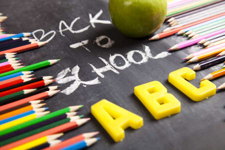 Apple, Colour pencils, Blackboard   photo