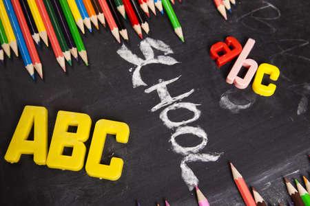 School, Colour pencils & Blackboard    photo