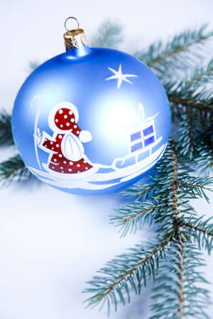 Blue Christmas bauble with ornament of Santa Claus Stock Photo