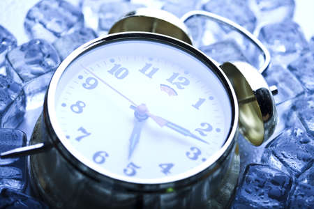 The time has come - alarm clock and ice Stock Photo - 5418887