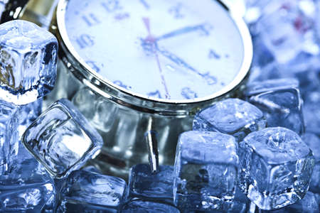 Classical Clock among ice cubes   photo
