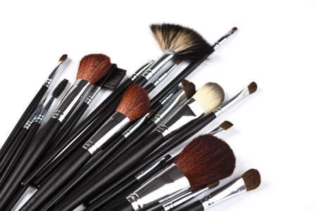 cosmetics collection: Set of professional makeup brushes on white background