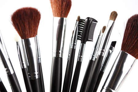 Set of professional makeup brushes on white background  photo