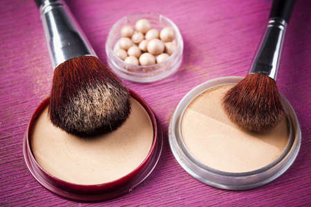 Face powder, make up powder on pink background   photo