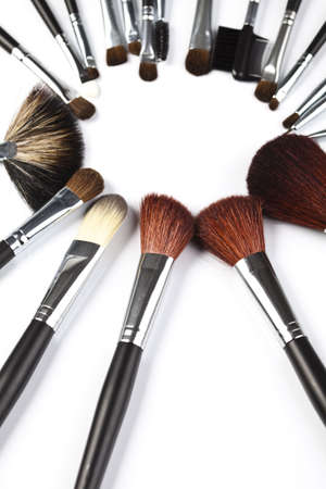 cosmetics collection: Set of cosmetic brushes on white background