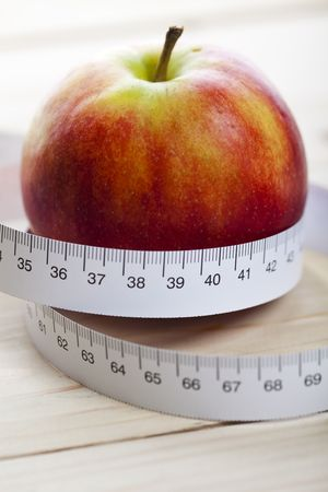 Apple and measurement tape photo
