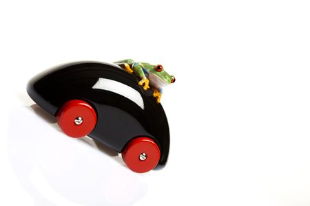lean out: Car toy and crazy frog Stock Photo