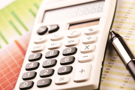 Calculator and diagram Stock Photo - 6537259