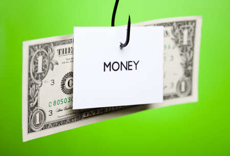 Dollar sign on piece of paper on hook Stock Photo - 7382671