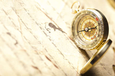 south india: Compass on the old paper background