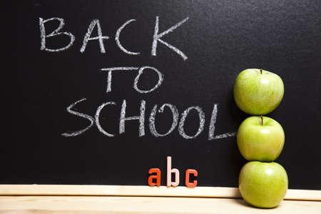 Inscription on a school chalkboard - back to school   photo