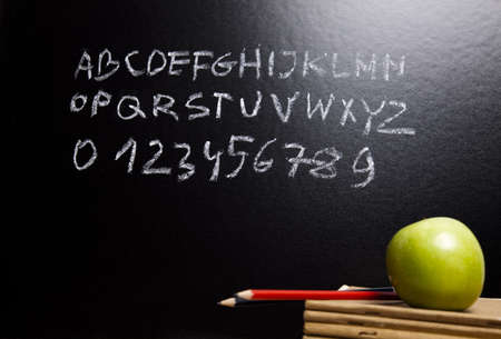 primary: Apple & School blackboard  Stock Photo