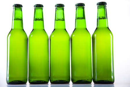 sapid: Bottle of beer with water-drop on white background
