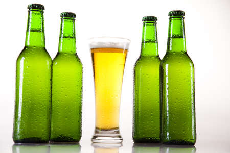 single beer bottle: Glass of beer on a white background