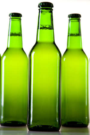 adjuvant: Bottles of beer against a white background