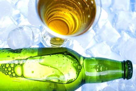 Green bottle of beer, ice