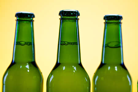 adjuvant: Green bottle of beer  Stock Photo
