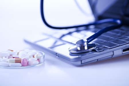 pharmacologist: Laptop, notebook and Stethoscope