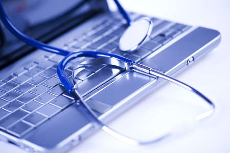 Laptop, notebook and Stethoscope photo