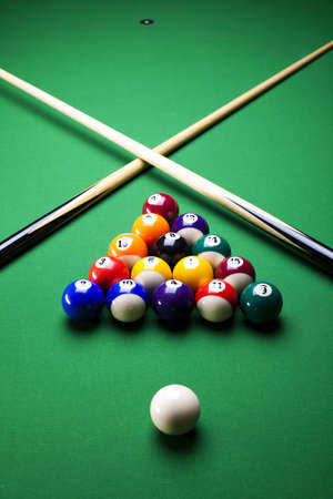 billiards tables: Pool sticks cross
