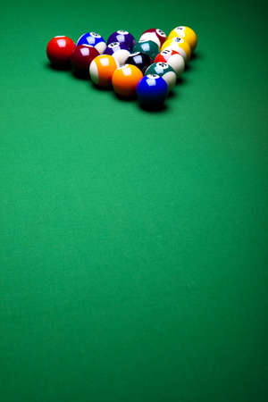 billiards tables: Pool game balls against a green