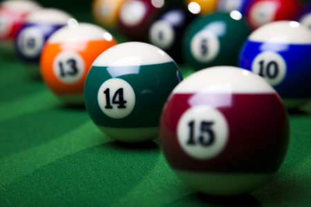 Pool game balls against a green Stock Photo - 8788869