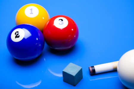 Billiard balls isolate on blue photo