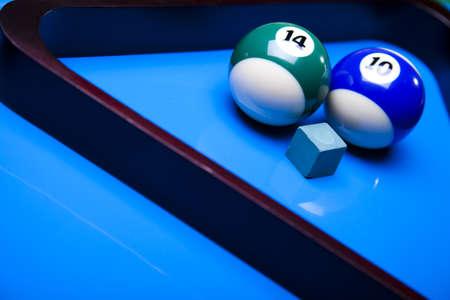 Billiard balls isolate on blue photo