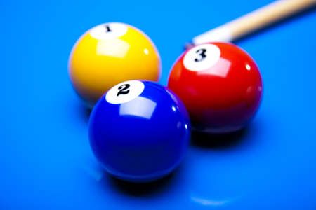 9 ball:  Billiard balls isolated on blue Stock Photo