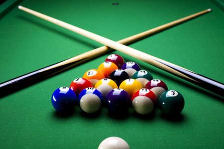 Pool sticks cross  photo