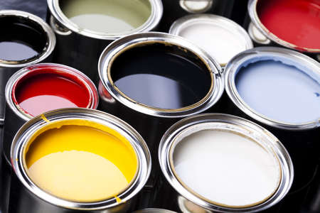 cans: Cans and paint on the colourful background Stock Photo