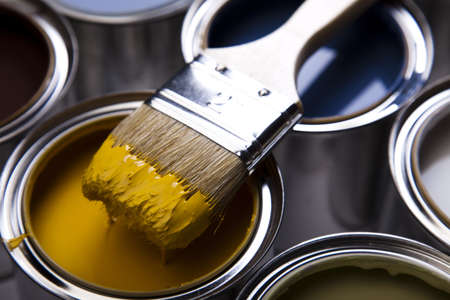 Cans and paint on the colourful background Stock Photo - 9118883