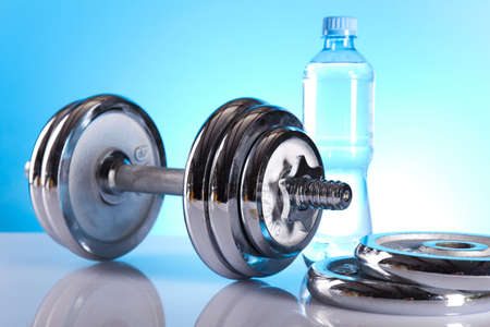 Dumbbell and bottle water Stock Photo - 9964078