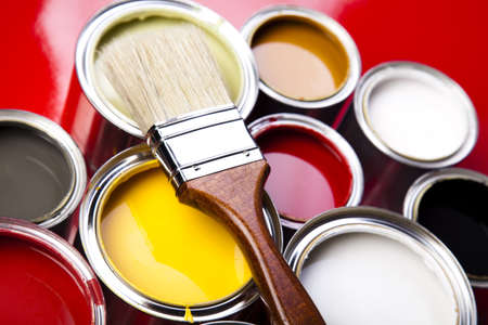 Cans of paint with paintbrush photo