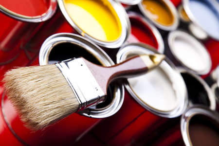 decorating: Cans of paint with paintbrush Stock Photo