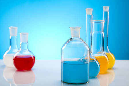 Laboratory flasks with fluids of different colors  Stock Photo