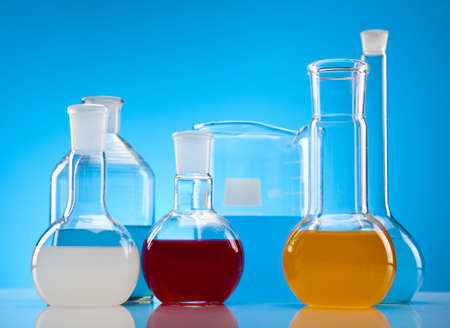 Laboratory flasks with fluids of different colors  photo