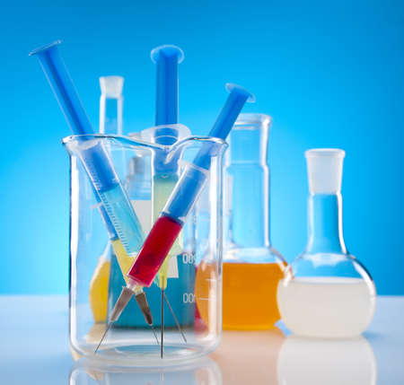 Laboratory flasks containing liquid color photo