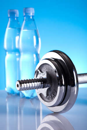 Dumbbell and bottle water Stock Photo - 9949462