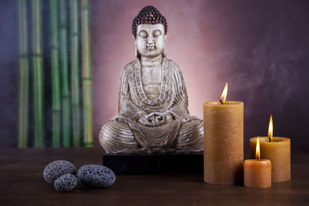 chinese buddha: Still life with buddha statue and bamboo Stock Photo