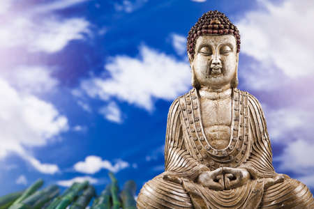 Buddha in Conceptual zen and blue sky photo