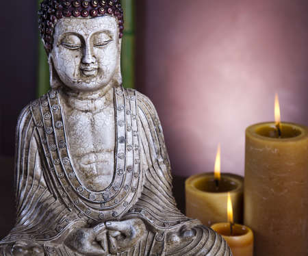 Buddha with candle photo