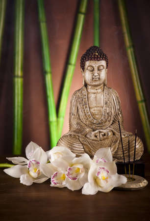 Buddha statue and bamboo photo