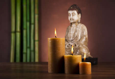 Still life with buddha statue and bamboo photo
