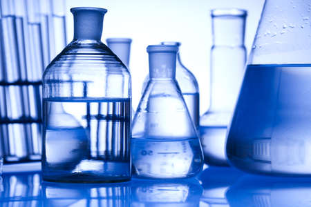 reagents: Glass laboratory equipment with blue background