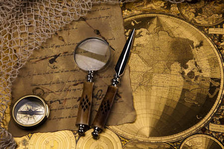 Old navigation instrument, map and compass photo